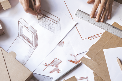 Drawing on table of custom packaging design sketches