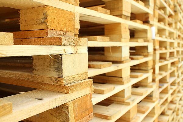 Stack of wooden pallets in warehouse